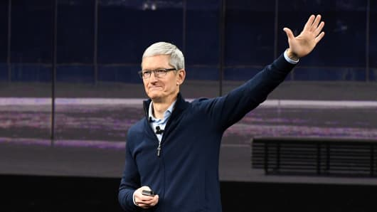 Tim Cook, chief executive officer of Apple Inc., waves after speaking during an event at the Steve Jobs Theater in Cupertino, California, U.S., on Tuesday, Sept. 12, 2017.