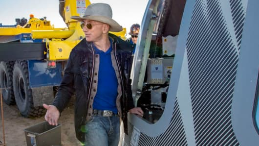 Jeff Bezos checking out Blue Origin's Crew Capsule 2.0 after touchdown in West Texas on December 12, 2017.