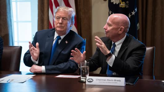 Chairman of the House Ways and Means Committee Rep. Kevin Brady, R-Texas, talks with President Donald Trump during a meeting on tax policy with Republican lawmakers in the Cabinet Room of the White House in Washington, DC on Thursday, Nov. 02, 2017.