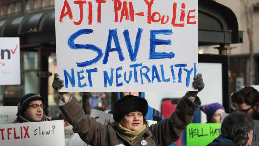Demonstrators, supporting net neutrality, protest a plan by the Federal Communications Commission (FCC) to repeal restrictions on internet service providers during a protest outside a Verizon store on December 7, 2017 in Chicago, Illinois.