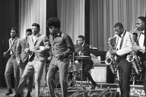 'Godfather of Soul' James Brown performs with The Famous Flames at the Apollo Theater in 1964 in New York, New York.