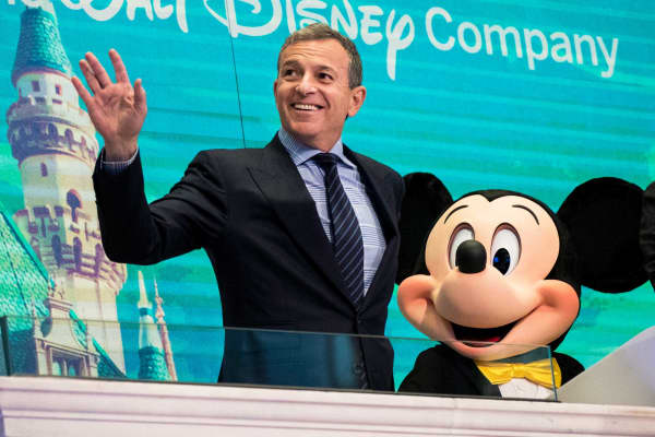 Chief executive officer and chairman of The Walt Disney Company Bob Iger and Mickey Mouse look on before ringing the opening bell at the New York Stock Exchange (NYSE), November 27, 2017 in New York City.