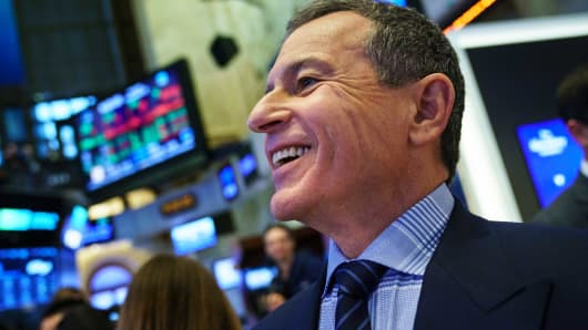 Chief executive officer and chairman of The Walt Disney Company Bob Iger walks on the floor of the New York Stock Exchange (NYSE) before ringing the opening bell, November 27, 2017 in New York City.