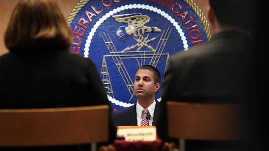 Federal Communications Commission Chairman Ajit Pai listens during a commission meeting December 14, 2017 in Washington, DC. The FCC is scheduled to vote on a proposal to repeal net-neutrality.
