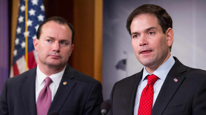 Sen. Marco Rubio (R-FL) speaks next to Sen. Mike Lee (R-Utah) during a news conference to introduce their proposal for an overhaul of the tax code, March 4, 2015 on Capitol Hill in Washington, DC.