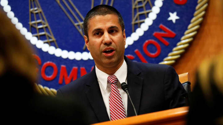 Chairman Ajit Pai speaks forward of the vote on the repeal of so called gain neutrality guidelines at the Federal Communications Commission in Washington, December 14, 2017.