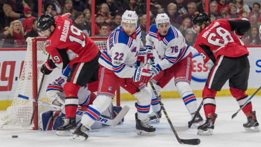 Ottawa Senators center Derick Brassard (19) recovers the puck following a shot on New York Rangers goalie Henrik Lundqvist (30) in the second period at Canadian Tire Centre.