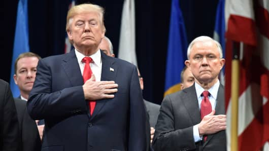 President Donald Trump, left, stands with Attorney General Jeff Sessions on December 15, 2017 in Quantico, Virginia, before participating in the FBI National Academy graduation ceremony.