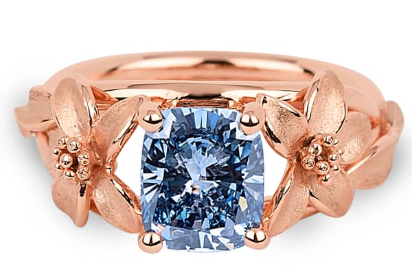 The Jane Seymour ring features a 2.08 carat, VS1 Fancy Vivid blue diamond set in 18-karat rose gold-plated platinum with floral motifs.