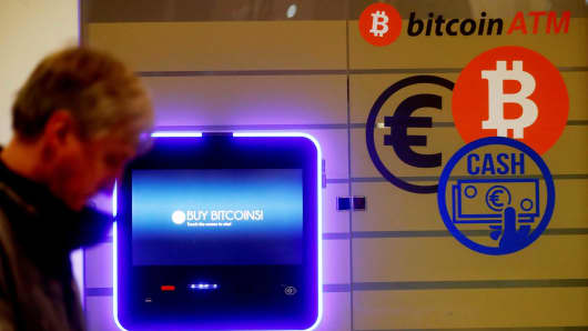 A man walks past a bitcoin ATM in Vilnius, Lithuania.