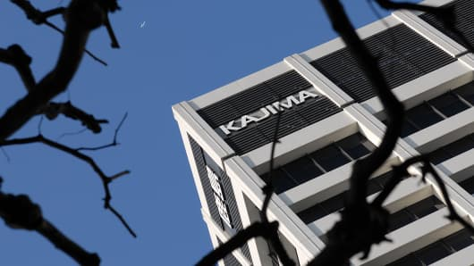 Kajima Corp.'s head office is seen against blue skies in Tokyo on Monday Jan. 22, 2007. Shares of Kajima Corp. and Obayashi Corp. led declines among Japan's largest builders after their offices were raided in a crackdown of possible illegal bidding in Japan's 53.5 trillion yen ($440 billion) construction market.