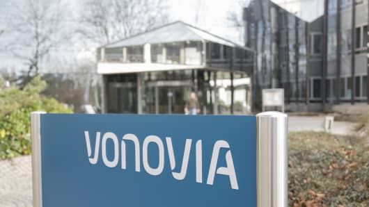 A sign stands outside the headquarter offices of Vonovia SE in Bochum, Germany, on Thursday, Feb. 11, 2016. Vonovia failed to get enough shares to acquire Deutsche Wohnen AG after a four-month takeover battle between Germany's largest property companies, ending what would have been the biggest ever deal in the country's real estate industry.