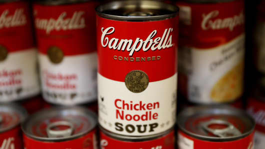 Cans of Campbell's soup are displayed on a shelf at Marinwood Market on November 21, 2017 in San Rafael, California.