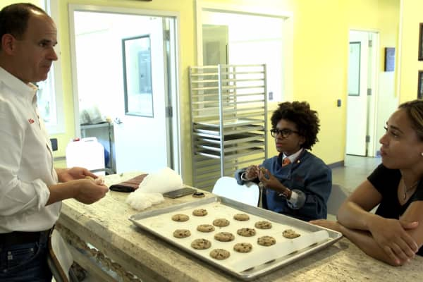 Marucs Lemonis in the kitchen with Cory Nieves and Lisa Howard of Mr. Cory's Cookies.