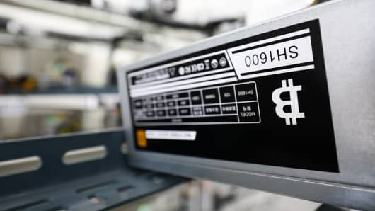 The bitcoin logo is displayed on a power supply unit at a cryptocurrency mining facility in Incheon, South Korea, on Friday, Dec. 15, 2017.