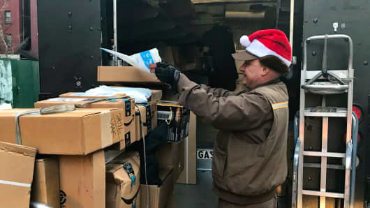 A UPS worker sorts packages in New York on Dec. 18th, 2017.