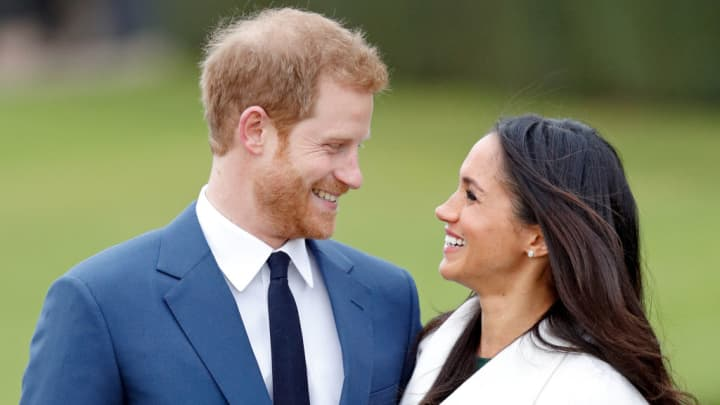 Prince Harry and Meghan Markle attend an official photocall to announce their engagement at The Sunken Gardens, Kensington Palace