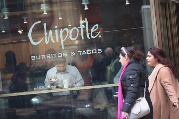 Diners expend at a Chipotle restaurant in Chicago.