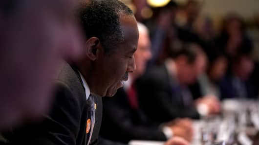 Secretary of Housing and Urban Development (HUD) Ben Carson leads U.S. President Donald Trump and his cabinet in prayer before a meeting at the White House in Washington, U.S., December 20, 2017.