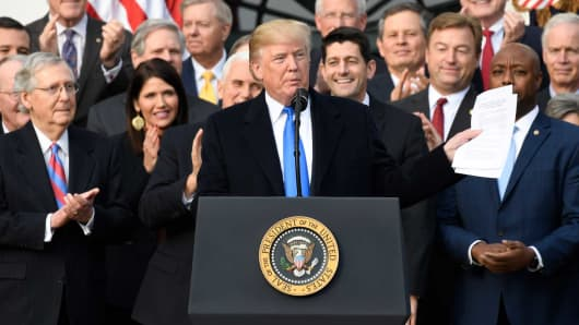 President Donald Trump speaks about the passage of tax reform legislation on the South Lawn of the White House in Washington, DC, December 20, 2017.