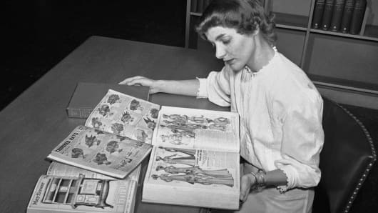 In this August 26, 1948 file photo, Ruth Parrington, librarian in the art department of the Chicago Public Library, studies early Sears Roebuck catalogs in the library's collection, in Chicago.