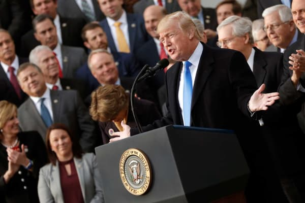 President Donald Trump celebrates with Congressional Republicans after the U.S. Congress passed sweeping tax overhaul legislation, on the South Lawn of the White House in Washington, December 20, 2017.