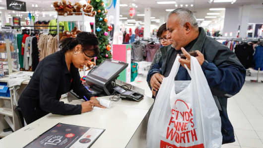 A shopper makes a purchase at the J.C. Penney department store in North Riverside, Illinois.