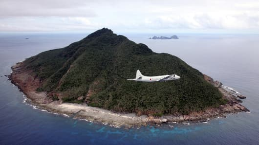 A Japanese Maritime Self-Defense Force flying over the disputed islets known as the Senkaku islands in Japan and Diaoyu islands in China, in the East China Sea.