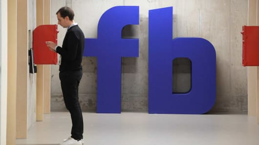 A man waits for an elevator at Facebook's headquarters in London.