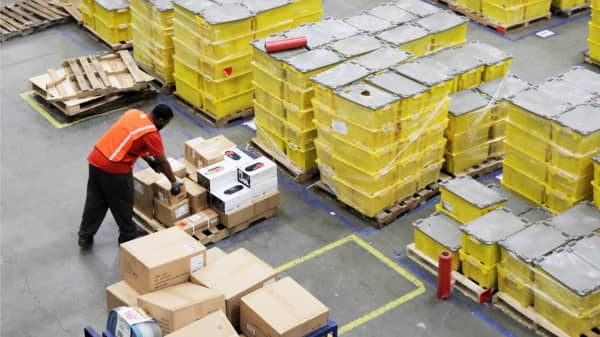 A worker stacks boxes inside of an Amazon fulfillment center in Robbinsville, New Jersey.