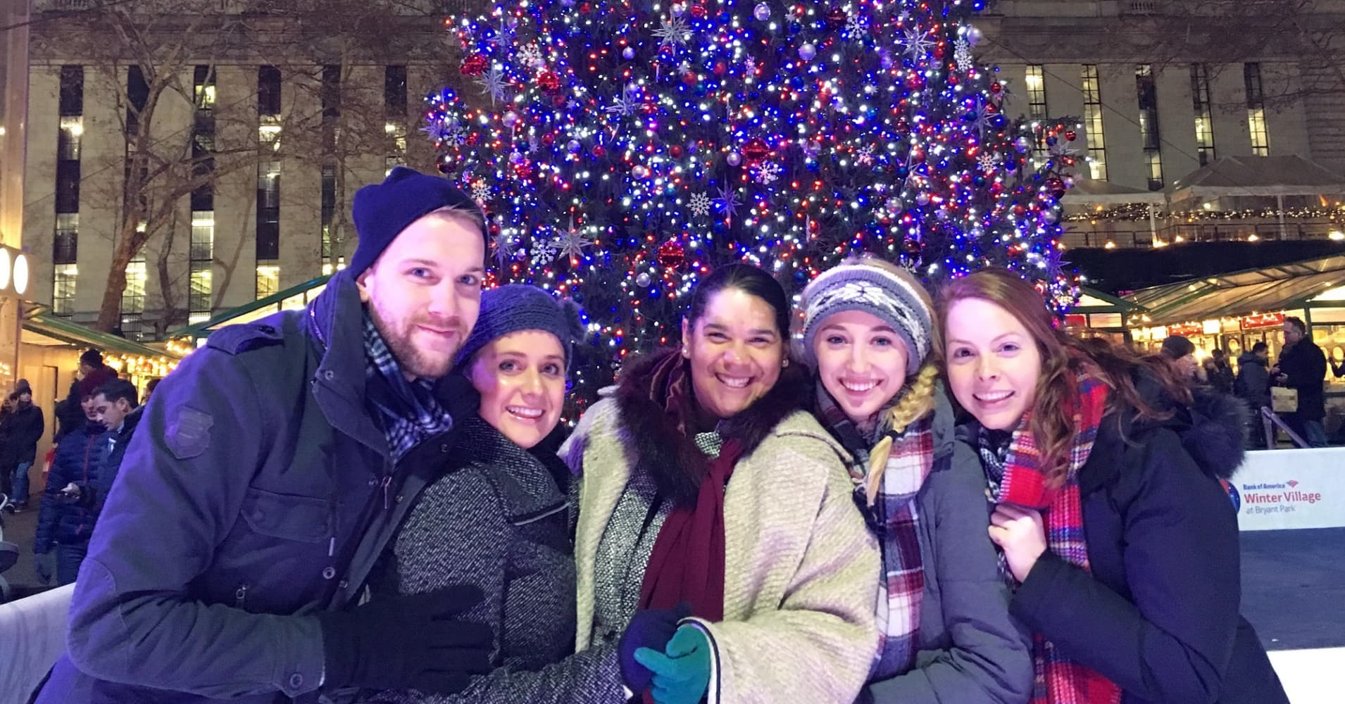 The author (far right) and friends ice skating at Bryant Park in 2017.