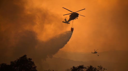 National Guard helicopters make water drop as the Thomas Fire approaches the Lake Casitas area on December 9, 2017 near Ojai, California.
