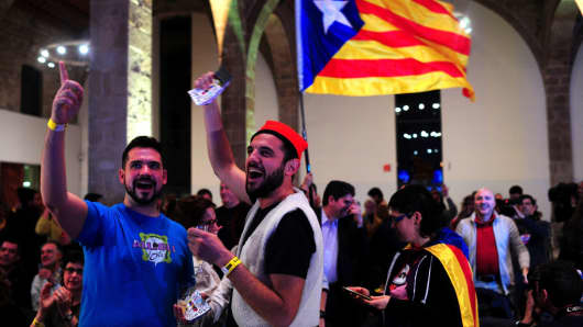 Pro-secessionist supporters react to election results for the Catalan National Assembly on December 21, 2017, in Barcelona, Spain.