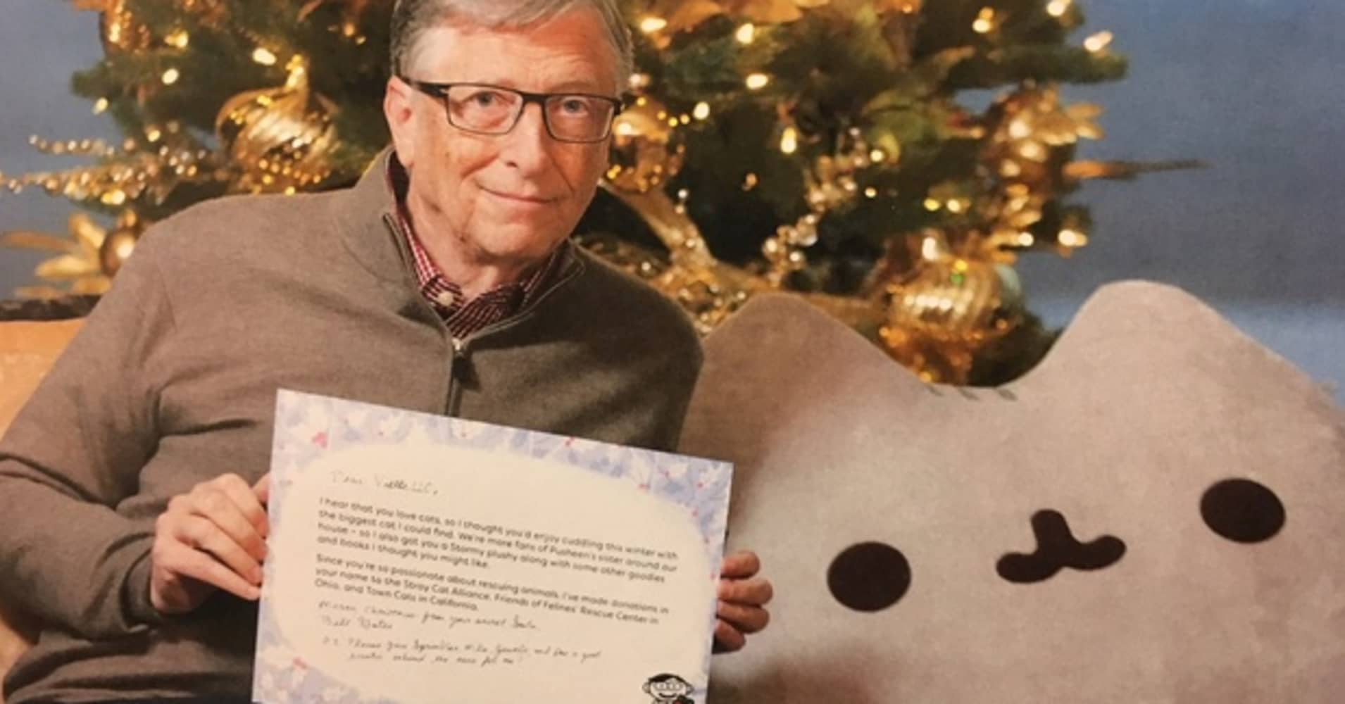 Bill Gates posing with the stuffed cat he gave his reddit Secret Santa, among many other generous gifts.