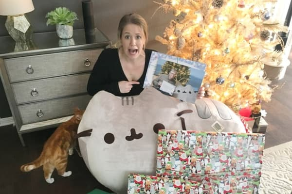 Megan Cummins with the gifts from Bill Gates