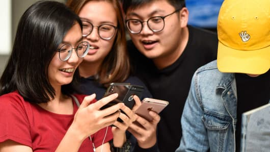 Excited newly-released iPhone X customers in Kuala Lumpur, Malaysia.