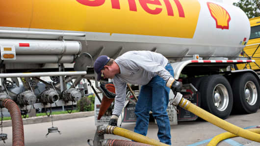 A driver delivers 7,500 gallons of unleaded gasoline to a Shell station in Peoria Illinois