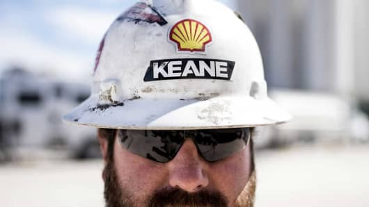 A worker wears a hard hat at a Royal Dutch Shell Plc hydraulic fracking site near Mentone, Texas.