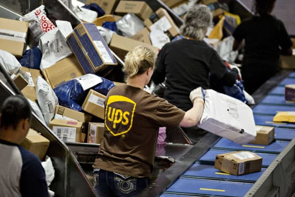 Employees sort packages at the United Parcel Service Inc. (UPS) Chicago Area Consolidation Hub in Hodgkins, Illinois.