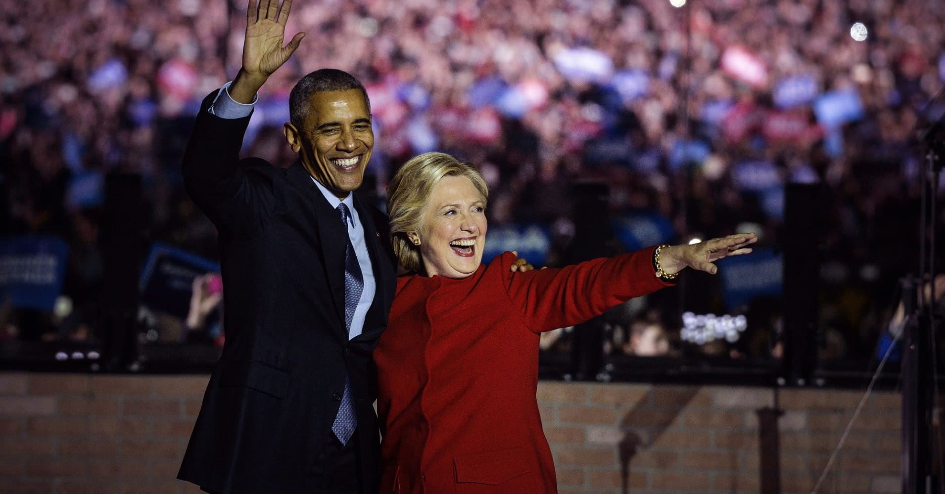 Hillary Clinton and Barack Obama wave to the crowd during a campaign event in Philadelphia, Pennsylvania.