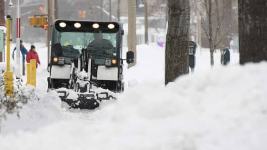 A snow plow removes snow after two days of record-breaking snowfall that had already surpassed 5 feet (1.5 meters), breaking city and state records, according to the National Weather Service in Erie, Pennsylvania, December 27, 2017.