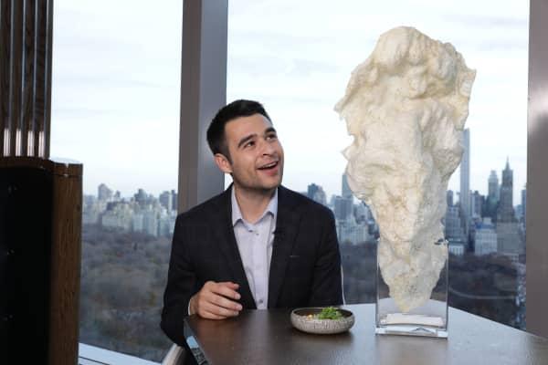CNBC correspondent Zack Guzman is dwarfed by a giant, $17 chicharon.