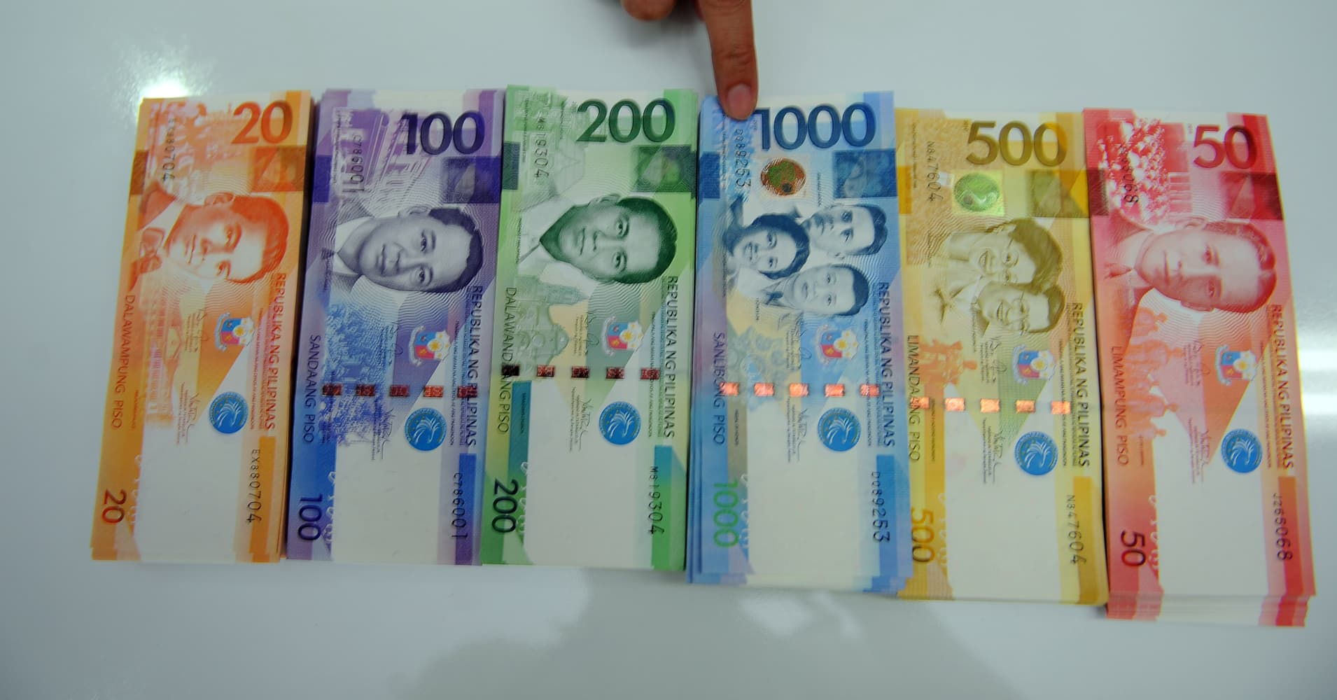 Philippines accidentally leaves former president's face off a batch of currency