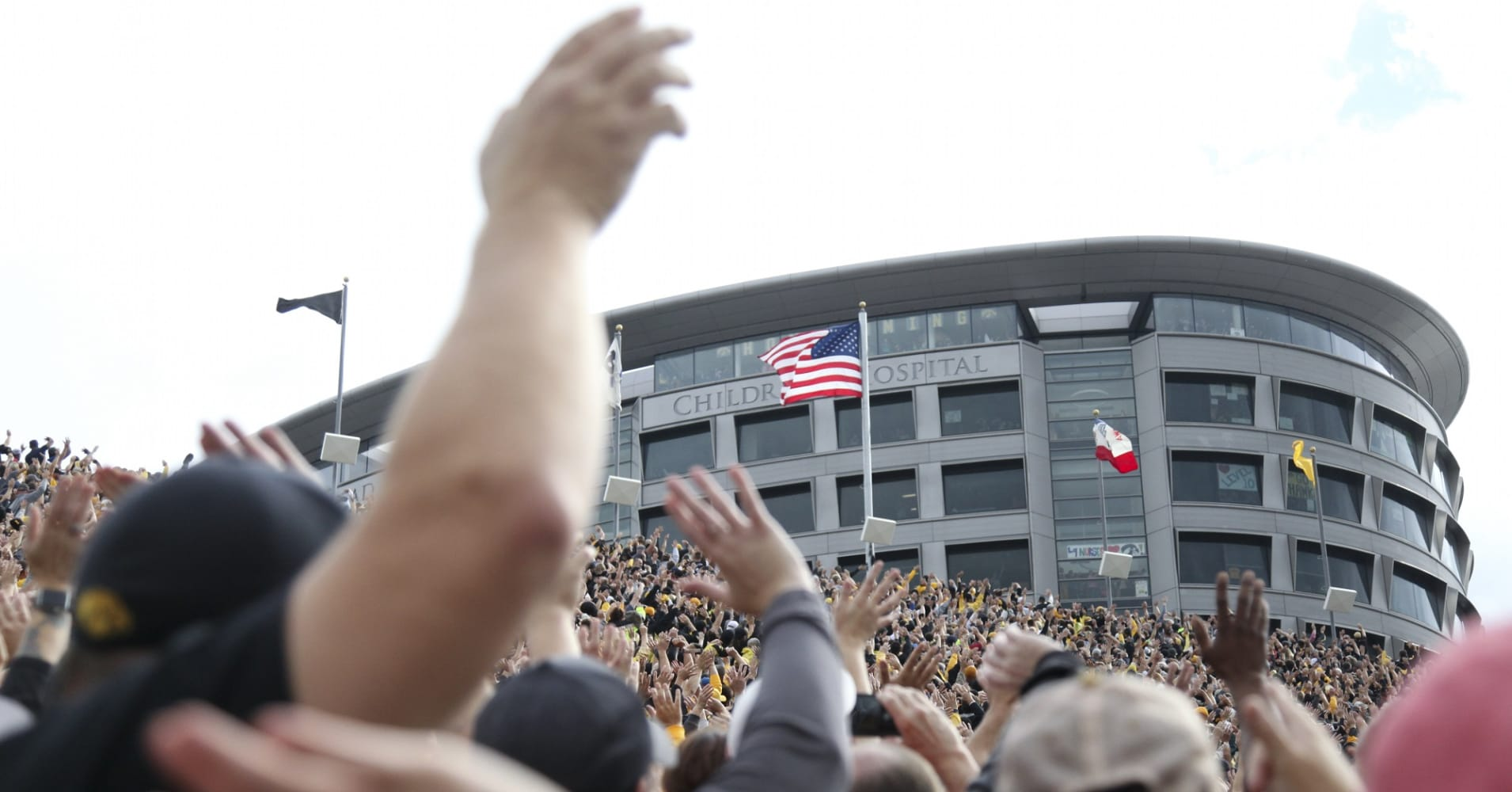 Fans wave to children at the University of Iowa Stead Family Children's Hospital after the first quarter of the Iowa football game against the Illinois Fighting Illini on October 7, 2017 at Kinnick Stadium in Iowa City, Iowa.