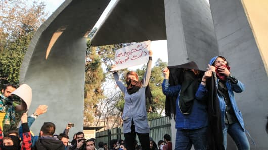People gather to protest over high cost of living in Tehran Iran
