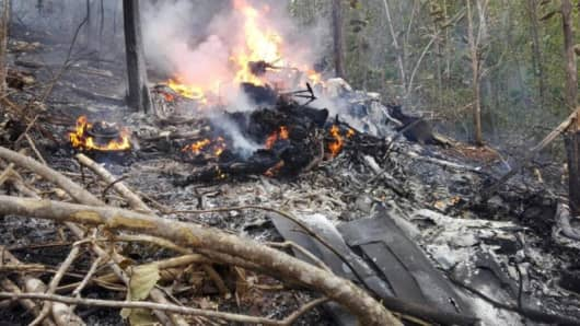 Wreckage in flames after a plane crashed in the mountainous area of Punta Islita, in the province of Guanacaste, in Costa Rica in this still image taken from social media video Dec. 31, 2017.