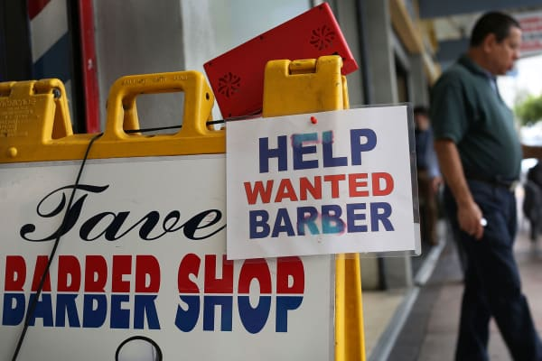 A Help Wanted sign at a barber shop in Miami.