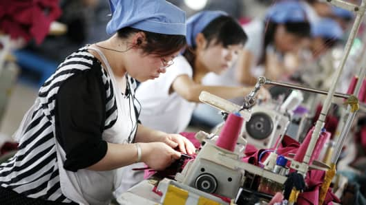 Chinese workers at a cloth factory in Huaibei, China.