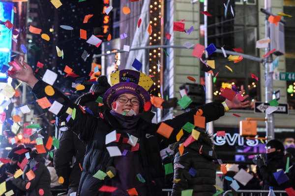 People throw confetti on New Year's Eve in Times Square on January 1, 2018 in New York City.