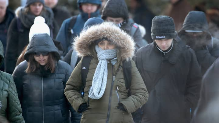 Commuters brave sub-zero temperatures as they make their way to work in the Loop on January 2, 2018 in Chicago, Illinois. Record cold temperatures are gripping much of the U.S. and are being blamed on several deaths over the past week.